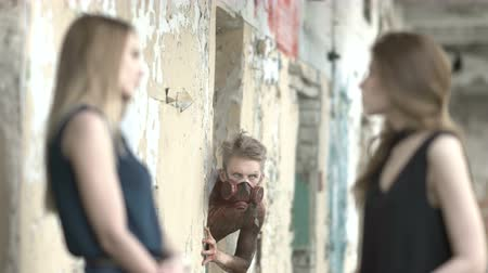przestępca : Girls talk near an abandoned house and maniac watches them Wideo