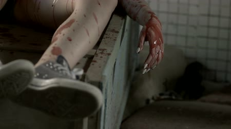bloody hands : Blood drips from the hand on the floor Stock Footage