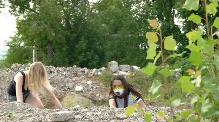 aftermath : Girls climb the ruins after the apocalypse Stock Footage