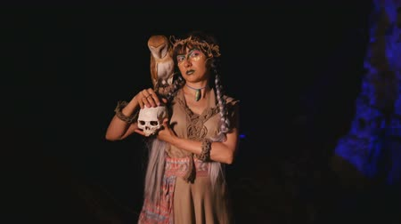 faerie : Fancy girl with owl on her shoulder holds a skull in her hand