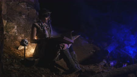 faerie : Fairy tale woman leaf through a big book Stock Footage