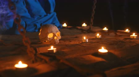 faerie : Human skull on a wooden suspension bridge among the candles Stock Footage