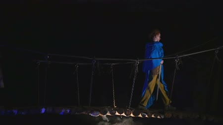 faerie : Fairy fantastic women in medieval clothes walking on a wooden suspension bridge Stock Footage