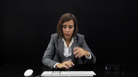 Businesswoman working at computer Stock Footage