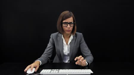 prehistory : Businesswoman working at computer Stock Footage