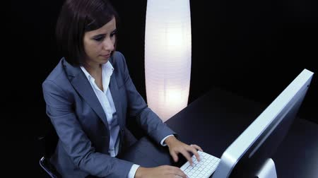 Woman works at the computer and showing an empty card