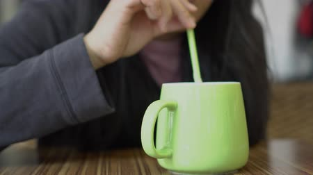 quiche : Asian woman drinking coffee with straw. Stock Footage