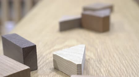 quebra cabeças : Different shapes of wood blocks. Placed on the wooden table.
