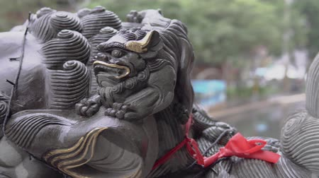 worship : Stone lion and classical architecture in Asian temple. Stock Footage
