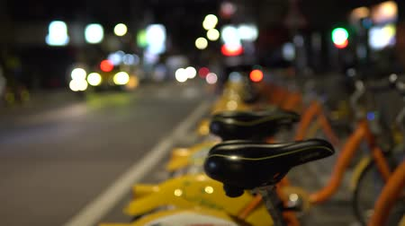 Bike for rent in Asia. Streetscape in the city at night.