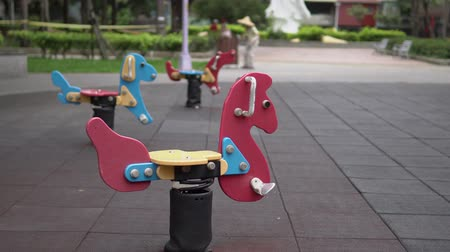 tırmanış : Colorful playground for kids. Amusement equipments in the park. In Asia. Stok Video