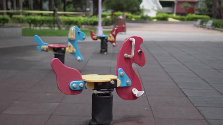 Colorful playground for kids. Amusement equipments in the park. In Asia. Stock mozgókép