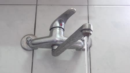 csőhálózat : Faucet with water in the bathroom. Water drop. Concept of water shortage, water resources, clean, Wash hands.