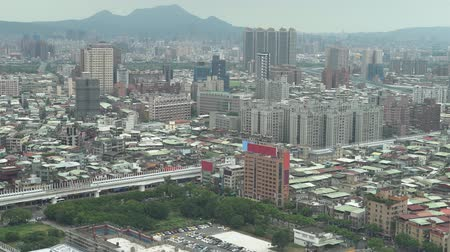 midtown : Aerial view of Asia city skyline with downtown buildings covered partially with roads.