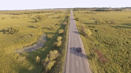 toy : Aerial view of car driving on highway around fields