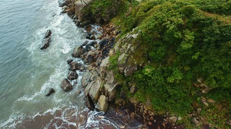 skalnatý : Aerial coastline view and waves crashing on rocky cliff shoreline