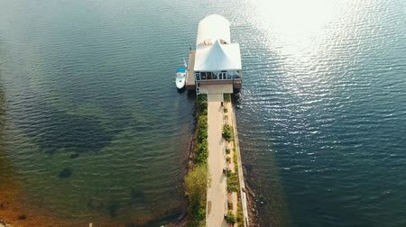 orbital : aerial view building on the pier, blue sea and wedding ceremonies Stock Footage