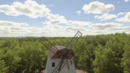торф : aerieal front view old windmill located near forest