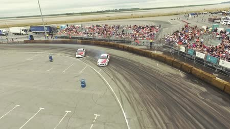 racers : Aerial shot of cars drifting with lots of smoke during drift competition Stock Footage