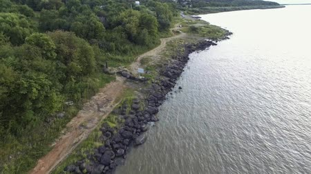 turkuaz : top aerial view of rocky coast of sikachi alyan Stok Video