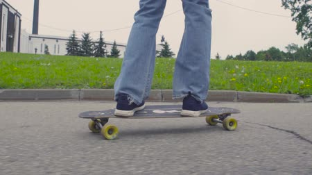 longboarder : Foots of young man riding on longboard Stock Footage