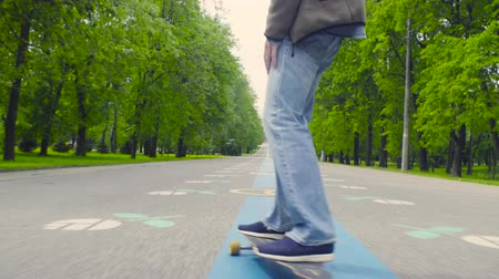 longboarder : Young man riding on longboard
