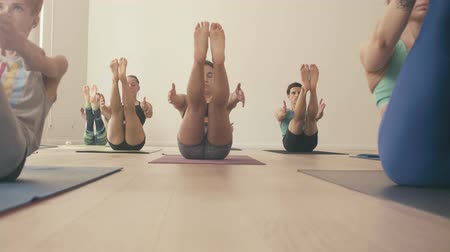 hall : Group of people doing yoga asanas in studio