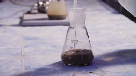 reseach : Scientist pouring water in a soil sample for reseach. Stock Footage