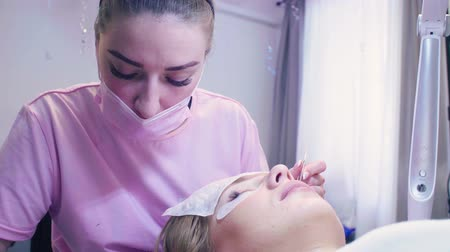 extremely : Eyelash extension procedure in a beauty salon