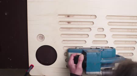 sander : Grinding a furniture part with a handheld machine Stock Footage