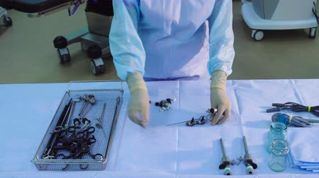 aseptic : A nurse putting on the table the medical trocars Stock Footage