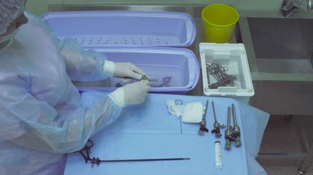 aseptic : The nurse washing medical instrument Stock Footage
