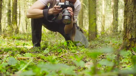 waders : The ecologist making photos in the forest. Stock Footage