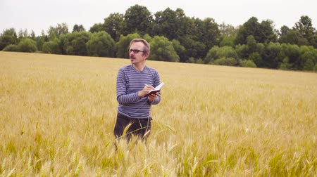 conservationist : The man ecologist examining wheat