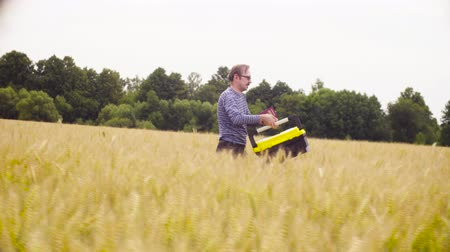 conservationist : The ecologist walking through the wheat field