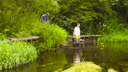 naturalist : Man and woman ecologist going into the river