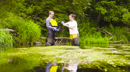 naturalist : Woman ecologist taking samples of water