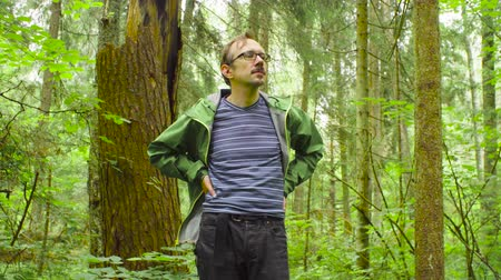 naturalist : The ecologist in a forest looking around