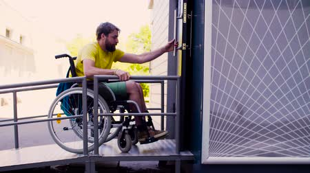 wheelchair ramp : Young disable man in wheelchair in the park