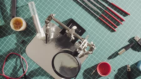 cutting mat : Table with tools for repairing of wire Stock Footage