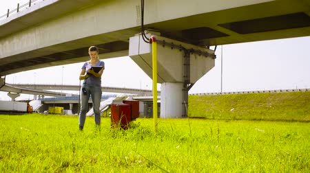 conservationist : Ecologist measuring the level of radiation near highway Stock Footage