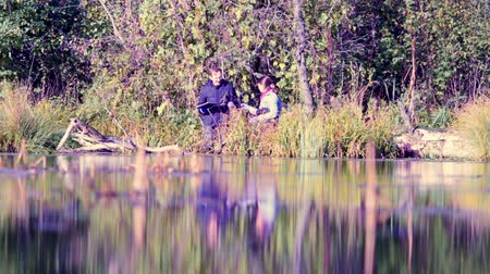 conservationist : Two scientists ecologists in wild forest on the river bank Stock Footage
