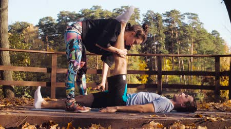 Woman doing stretching exercises for a man