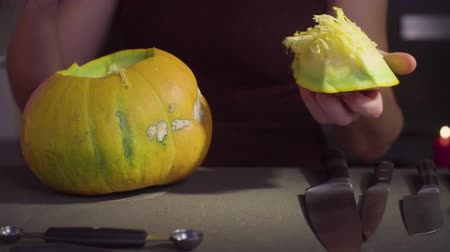 salva : Woman carves from a pumpkin Jack-o-lantern for Halloween celebration Dostupné videozáznamy
