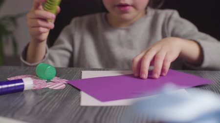 album de recortes : Girls hands glueing a card. Valentines Day Archivo de Video