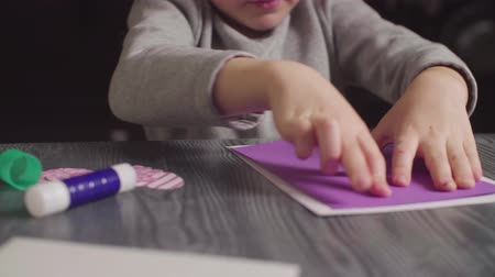 scrapbook : Girls hands glueing a card. Valentines Day Stock Footage