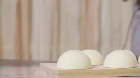 pan shot : Cooking cakes with white velour coating Stock Footage