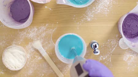 pan shot : Hands of confectioner mixing components for mirror glaze