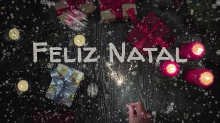 natal : Animation Feliz Natal - Merry Christmas in portuguese, female hand holding a sparkler.