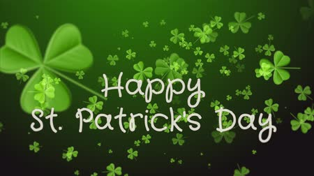 kelt : Happy Saint Patricks Day. Falling clover leaves over dark green background